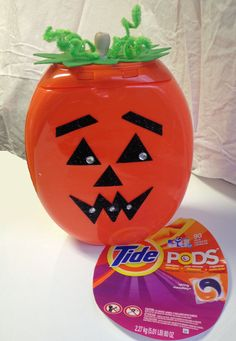 Candy jar made from Tide Pods container.  Just remove the labels (a hair dryer helps with this) and decorate the way you want!