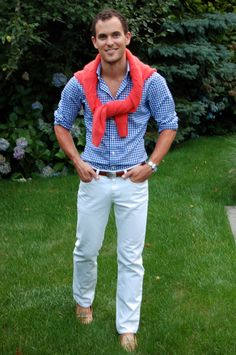 Blue gingham short, white Chico pants, and coral cardigan with brown belt and tan loafers.