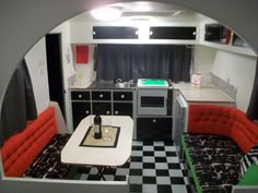 Black and white and red vintage caravan