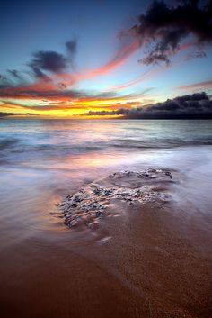Sunset over Coral at Ka'anapali Beach, Maui Hawaii By Conrad...
