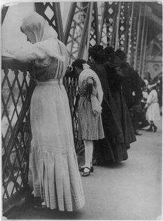 Rosh Hashanah 1909    Praying on the Williamsburg Bridge, NYC    It is customary on Rosh Hashanah to pray near naturally flowing water, symbolically casting away your sins.  Sometimes pebbles or small pieces of bread are thrown