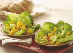 Orange-Almond Salad in Lettuce Cups   -Ingredients        1/4  cup orange juice      2  tablespoons honey      1/2  teaspoon Dijon mustard      12  Bibb lettuce leaves      2  medium oranges, peeled, divided into segments, membrane removed and cut into thirds      1/4  cup chopped smoked almonds