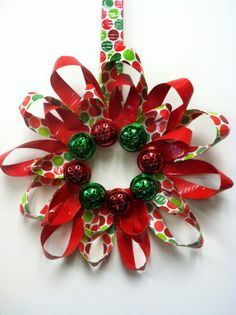 Patterned and plain duct tape mix to create a mod wreath. For instructions, click the pic. duct tape, holiday wreaths, tape wreath, duck tape