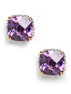 Oversized glass stud earrings in a feminine hue are the prettiest understated accent. Glass cushion cut stones in a rich amethyst hue are set in a gold-tone base.