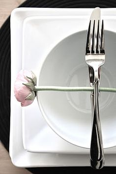 What a cute idea! or if you put a flower head in the middle of the bowl under the silverware. classy yet creative :)