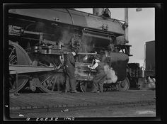 Woman railroader learning to grease an engine wheel, San Francisco, 1943.