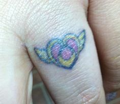 Sailor moon crisis tattoo by JapChrissy82.deviantart.com on @deviantART Looks a little funny because I just put some creme on it... I never wear my wedding ring because I work with acrylics at work (dental lab). So I wanted to get something so I didnt have to wear my ring anymore.