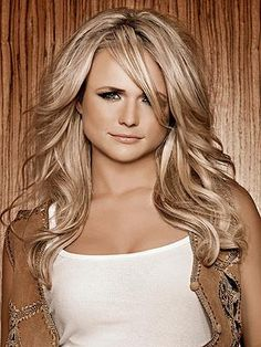 Miranda Lambert she is seriously my idol. She is so beautiful and doesn't care what anyone has to say. And she isn't a twig like all the other girls are. I hope to meet her one day!