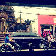 Juxtaposition: Kuta, Bali. Today's Bali is an intriguing mix of culture & commercialisation    me: agree