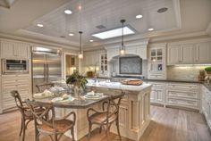 Beautiful kitchen. really like those chairs.
