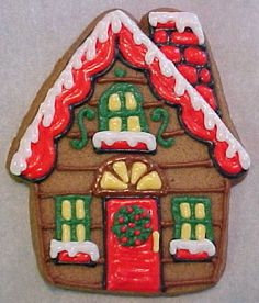Adorable gingerbread house Christmas cookie with glaze icing