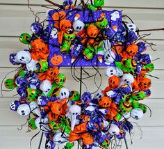 Halloween Candy Wreath ~ Over 150 individually wrapped Tootsie Pops in Halloween fabric.    Competition:  NC Mountain State Fair; September 2011