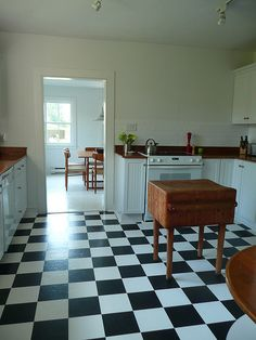 I'm drooling over this checker board kitchen and butcher block