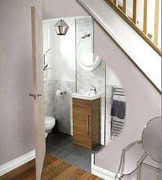 Bathroom under stairs on pinterest small toilet closet under stairs