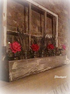 Attach wooden flower box to old window frame, add mason jars ( with flowers ) or plants