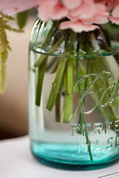 Aqua mason jar with pink flowers