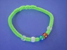 water cycle bracelet :)  String the following beads on the pipe cleaner in this order: clear bead (evaporation), white bead (condensation), blue bead (precipitation), red bead (accumulation), and clear bead (evaporation). Adjust the pipe cleaner to the child's wrist, twist, and trim off excess.