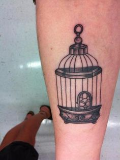 Birdcage arm tattoo
