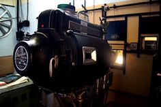 This blog post is all about the original 1930s fire prevention system in the projection room at the Regal Cinema in Tenbury Wells. This photo shows our 35mm projector at its best, along with the fire shutters and even a film reel on the wall in the background!