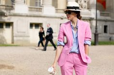 A pale blue striped shirt has a surprisingly softening effect on a killer pink suit.
