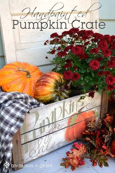 Rustic Fall...pumpkin crate, old door  mums.   Handpainted crate by Jamie of Anderson + Grant.