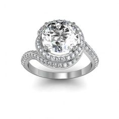 This unique engagement rings halo is formed by the wraparound shank.  #engagement #engagementrings #jewelry #artdeco #weddings #uniqueengagementrings $1757