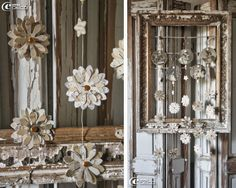paper flowers from sheet music & old books in a chippy frame.