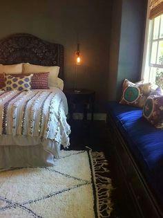 Boho bedroom seating near window