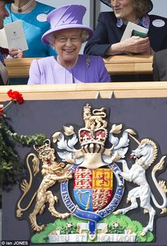 The Queen looks happy in the Royal Box at Royal Ascot
