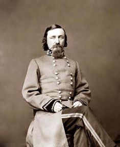 The photograph presents General George E. Pickett sitting in Confederate Uniform. General Pickett is famous for Pickett's Charge at the Civil War Battle of Gettysburg, where his regiment charged a Union Entrenched Position across an open field. Most of his regiment was lost, but the charge goes down as one of the bravest and most heroic events of all history. 1860-65