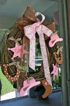 Pink Cowgirl Wreath - birthday or baby shower - I like this idea, but for the outside of my girls door with a different ornament each birthday either her picture in the back. Could do for the boys - cowboy & John deer?!