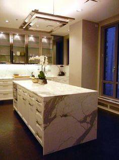 metal kitchen cabinets & island countertop treatment--IPD Partners Inc.