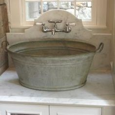Washtub Sink. This would be cute in a laundry room. I'd have it sit lower, so it'd be easier to use.  k ~