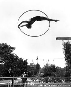 """Aug. 30, 1931: """"A new turn in the history of diving"""" at a pool in Los Angeles, where Georgia Coleman — in preparation for the 1932 Summer Olympics there, where she won two medals — practiced """"a complicated fancy dive."""" Photo: The New York Times"""