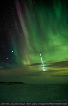 Meteor Magic - streaking fireball and colorful aurora over a snow-covered lake in Canada.