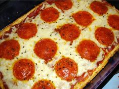 Low Carb Pizza with crust made from cream cheese, eggs, parmesan cheese, mozzerella and heavy cream.