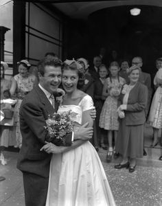English actress Nanette Newman, 21, and actor-writer Bryan Forbes are shown after their wedding at London's Caxton Hall Register Office, on August 27, 1955. They were married for 58 years, until Forbes' death in 2013. (AP Photo/John Rider)