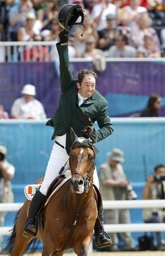 Cian O'Connor of Ireland riding Blue Loyd 12 celebrates after performing during the equestrian individual jumping final at the London 2012 Olympic Games in Greenwich Park August 8.