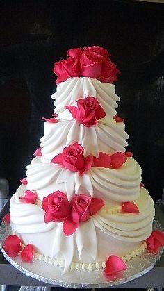 Gorgeous pink and white, draped wedding cake