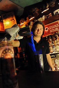Supagroups Benji Lee moonlights behind the bar at The Saint, a dive bar like no other, where every kind of character in new Orleans will show up. Celebrities often mix in with the usual crowd to enjoy some of the finest crafted cocktails in town. #NewOrleans #MagazineStreet #NOLA