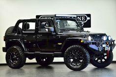 Jeep Wrangler Unlimited Sahara on 20's
