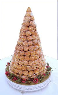 Croquembouche is a traditional# wedding# cake# in France.  Pretty much like little cream puffs assembled into a pyramid shaped cake.