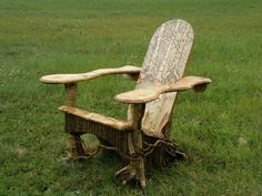 Coolest Adirondack chair I've ever seen: root legs, twig work, chiseled seat and arms and woodland art on seat back - BEAUTIFUL!!  -made by Steve Bowers at Bald Mountain Rustics