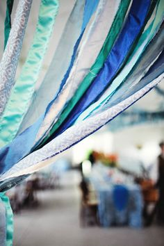 ripped ribbon streamers, photo by Haley George Photography http://ruffledblog.com/handmade-south-carolina-wedding #garlands #streamers