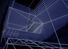 House renovation plans outlined with illuminated white strings.
