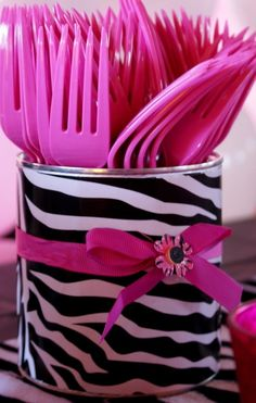silverware holder out of a soup can  some scrapbook paper--I would also use this idea for organizing office supplies.