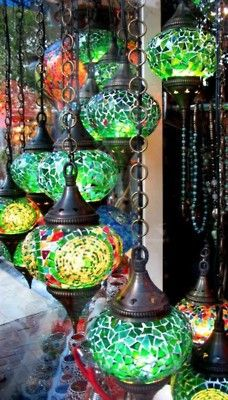 love the colored lights...can see these on a bright, morrocan style patio :)