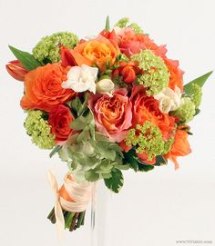Hand-tied bridal bouquet in orange and green with roses and viburnum, Pantone Nectarine and Tender Shoots color scheme.