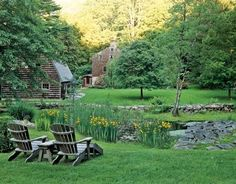 A natural pond and low-rising, mortarless stone walls adorn this backyard garden.