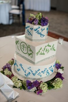 Our awesome wedding cake! We had each guest's name written on the cake to show them how happy we were that they could share this special day with us. It was a big hit!                                                               Photo By Timeless Elegance Photography